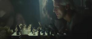 Batty examines Sebastian's chess game.